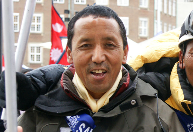 "Apa (born Lhakpa Tenzing Sherpa; 20 January 1960),nicknamed ""Super Sherpa"", is a Nepalese Sherpa mountaineer who, jointly with Phurba Tashi, holds the record for reaching the summit of Mount Everest more times than any other person. As part of The Eco Everest Expedition 2011, Apa made his 21st Mount Everest summit in May 2011."