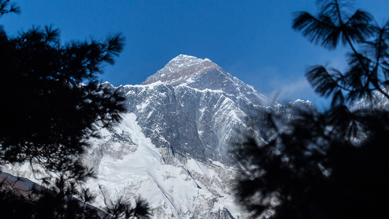 Mount Everest under the clear blue sky.