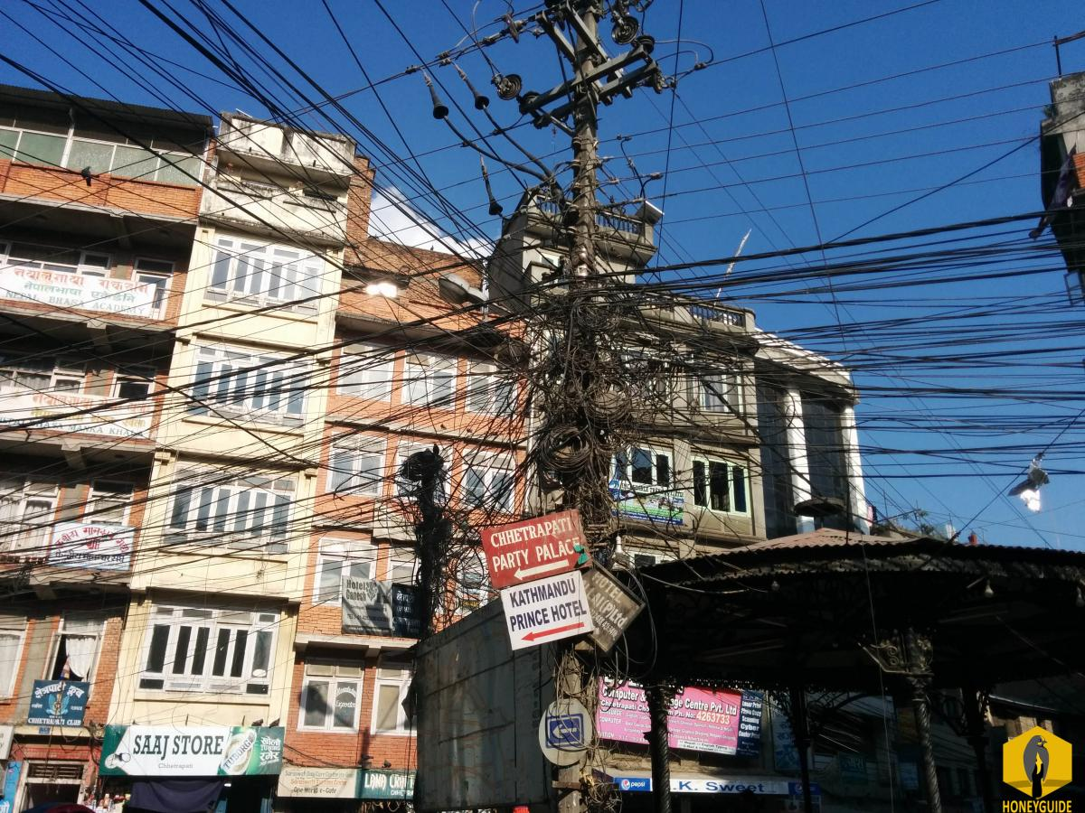 Funny things in Kathmandu. Wires all over the head of the people living in the Kathmandu.