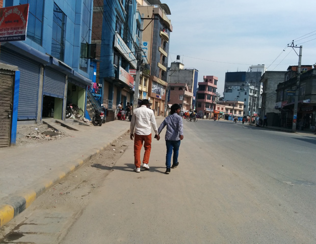 Guys holding hands in streets of nepal