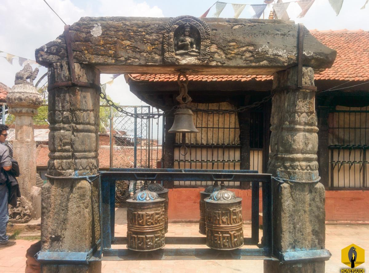 Prayer wheels and Hindu God in the same place at Chilancho Vihar in Kirtipur, Nepal