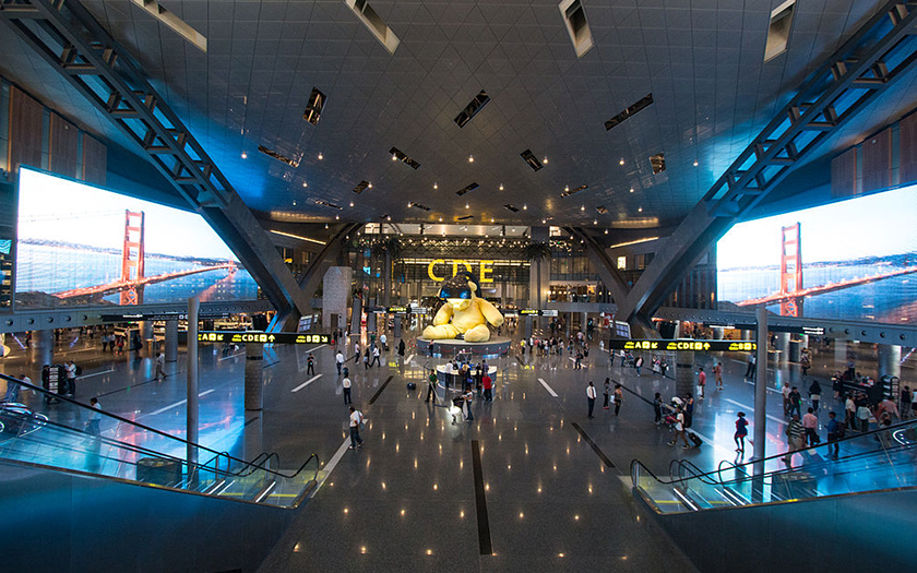 Hamad International Airport - One of its giant halls with two giant TV screens