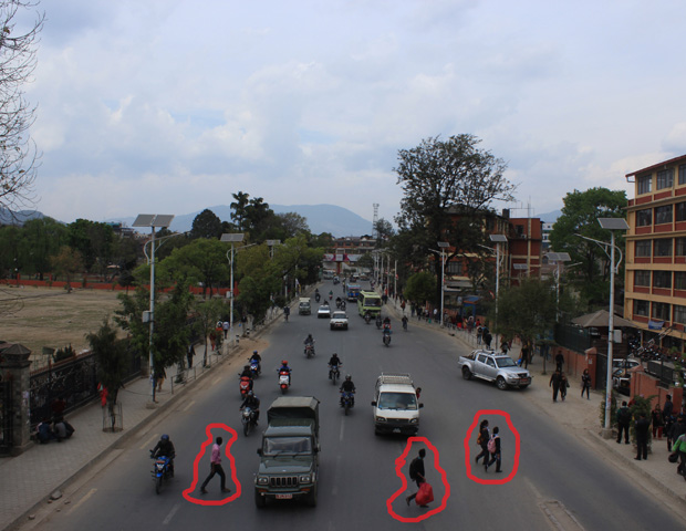 People crossing streets in Nepal
