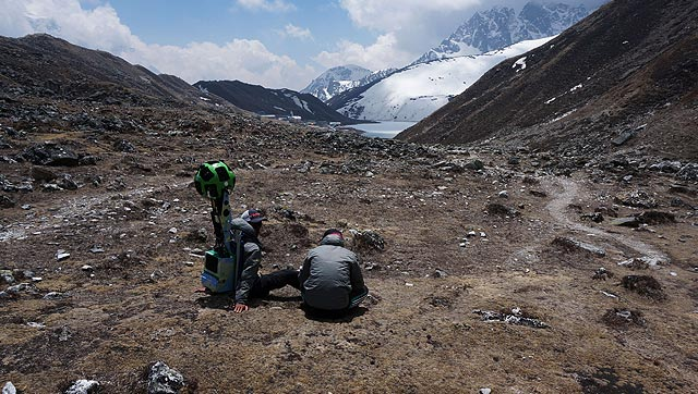 Memebers of the Google Street View project sit with the camera used to capture project footage in Nepal's Khumbu region. Photo: AFP